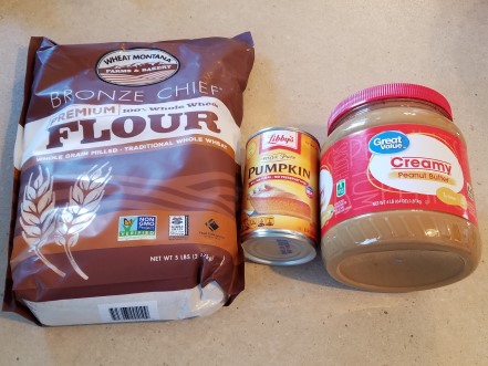 Flour, canned pumpkin, and peanut butter for dog treats.