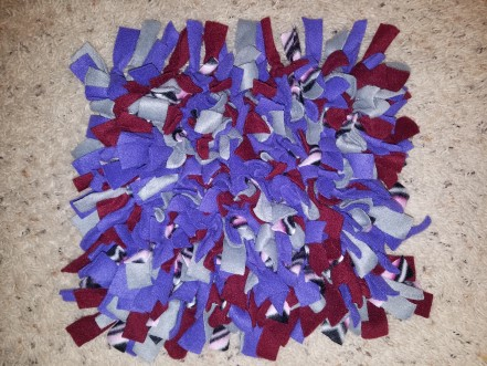 Multicolored snuffle mat for dogs.