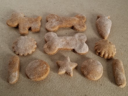 Baby food dog treats in different shapes like dogs and bones.