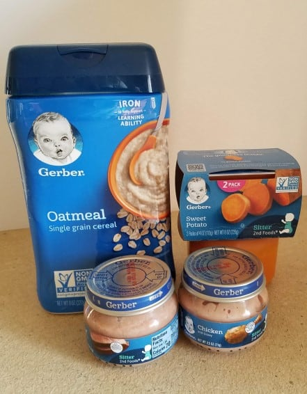 Oatmeal baby cereal, sweet potato baby food, and chicken baby food.