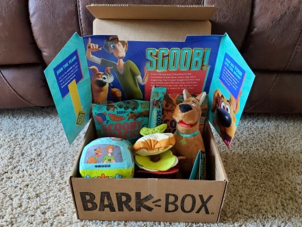 BarkBox with Scooby Doo themed dog treats and toys in it.